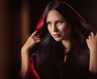 Beautiful woman with black cloak Royalty Free Stock Image