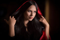 Beautiful woman with black cloak Royalty Free Stock Photos