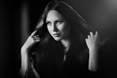 Beautiful woman with black cloak Stock Image