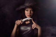 Beautiful woman with black cloak Royalty Free Stock Photos