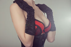 Beautiful woman in black corset and red bra Stock Photo