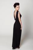 Beautiful woman in a black dress Stock Image