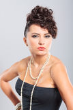 Beautiful woman in black dress Stock Photography