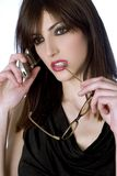 Beautiful woman in black dress. On white background talking on the cell phone royalty free stock image