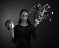 Woman with carnival masks. Beautiful woman in black dress with carnival masks Stock Images