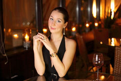 Woman in a black dress on a dark background Royalty Free Stock Photo