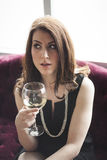 Beautiful Woman in Black Dress  Drinking White Wine Royalty Free Stock Images