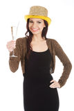 Beautiful woman in black dress and golden hat with champagne. Royalty Free Stock Images