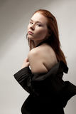 Beautiful woman in black dress with naked shoulder Stock Photo