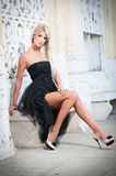 Beautiful woman in black dress posing outdoor Royalty Free Stock Photography