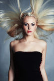 Beautiful woman in black dress. blond girl. Beautiful healthy hair.Beauty salon Stock Photos