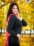 Beautiful woman in black dress in yellow city park, fall season Stock Image