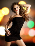 Beautiful woman in black dress. stock photography