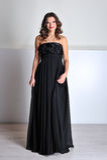 Beautiful woman in black evening dress Stock Photos
