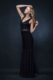 Beautiful woman in a black evening dress, Royalty Free Stock Photos