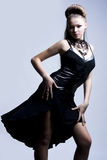 Beautiful woman in black evening gown Stock Image