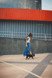 Beautiful woman with black french bulldog puppy at the street Stock Photography