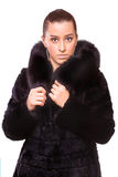 Beautiful Woman in black Fur Coat. isolated Stock Photo