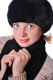 Beautiful woman in black fur hat Stock Photography