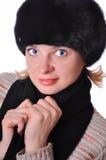 Beautiful woman in black fur hat Stock Photography