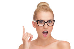 Beautiful woman in black glasses pointing up. Stock Photos