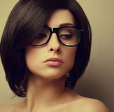 Beautiful woman with black hair in fashion glasses Stock Photo