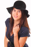 Beautiful woman in a black hat Stock Photography