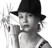 Beautiful woman with black hat Stock Image