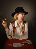 Beautiful woman in a black hat with a cigar Stock Images