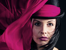 Beautiful woman in black hat with purple scarf Royalty Free Stock Photo