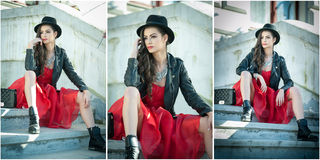 Beautiful woman with black hat, red dress and boots posing sitting on stairs. Young brunette spending time during autumn Royalty Free Stock Photos