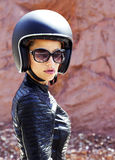 Beautiful woman in black helmet and leather jacket Stock Photos
