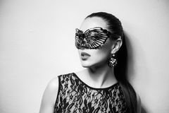 Beautiful Woman with Black Lace mask over her Eyes. Red Sexy Lips and Nails closeup. Royalty Free Stock Photos
