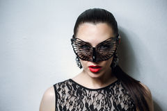 Beautiful Woman with Black Lace mask over her Eyes. Red Sexy Lips and Nails closeup. Open Mouth. Manicure and Makeup. Make up concept. Passion. Beautiful Royalty Free Stock Photo