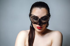 Beautiful Woman with Black Lace mask over her Eyes. Red Sexy Lips and Nails closeup. Royalty Free Stock Image