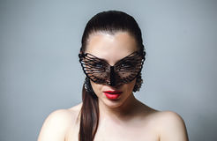 Beautiful Woman with Black Lace mask over her Eyes. Red Sexy Lips and Nails closeup. Royalty Free Stock Photo