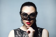 Beautiful Woman with Black Lace mask over her Eyes. Red Lips and Nails closeup. Royalty Free Stock Photography