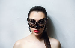 Beautiful Woman with Black Lace mask over her Eyes. Red Lips and Nails closeup. Royalty Free Stock Photo