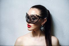 Beautiful Woman with Black Lace mask over her Eyes. Red Sexy Lips and Nails closeup. Stock Image