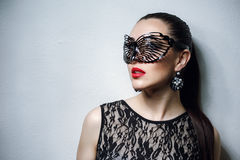 Beautiful Woman with Black Lace mask over her Eyes. Red Sexy Lips and Nails closeup. Open Mouth. Manicure and Makeup. Make up concept. Passion. Beautiful Stock Photography