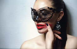 Beautiful Woman with Black Lace mask over her Eyes. Red Sexy Lips and Nails closeup. Stock Images