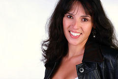 Beautiful woman in black leather. A beautiful hispanic woman wearing a black leather jacket royalty free stock image