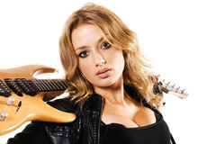 Beautiful woman in black leather clothing Stock Images