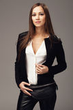 Beautiful woman with a black leather fanny pack. Elegant woman with a black leather fanny pack Stock Images