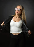 Beautiful woman in black leather jacket and sunglasses . Royalty Free Stock Photos