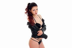 Beautiful woman in black lingerie and leather jacket looking at the camera Royalty Free Stock Photo