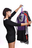 Beautiful woman black mini dress chooses clothes Stock Photography