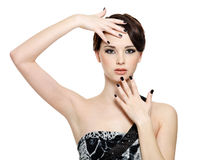 Beautiful woman with black nails Stock Photography