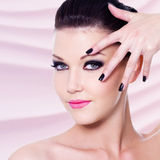 Beautiful woman with black nails and makeup Stock Images