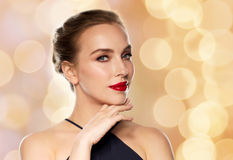 Beautiful woman in black over holidays lights Royalty Free Stock Photography